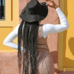 a woman in braids with her back to the camera