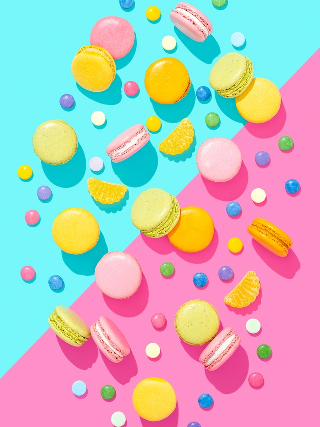 macaroons on a blue and pink background