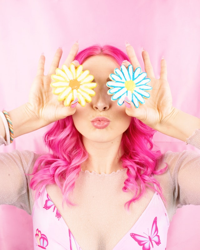 pink haired woman with flowers - earn money freelance writing