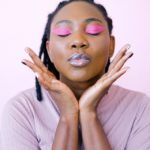 woman in pink eyeshadow - work at home mom blogs