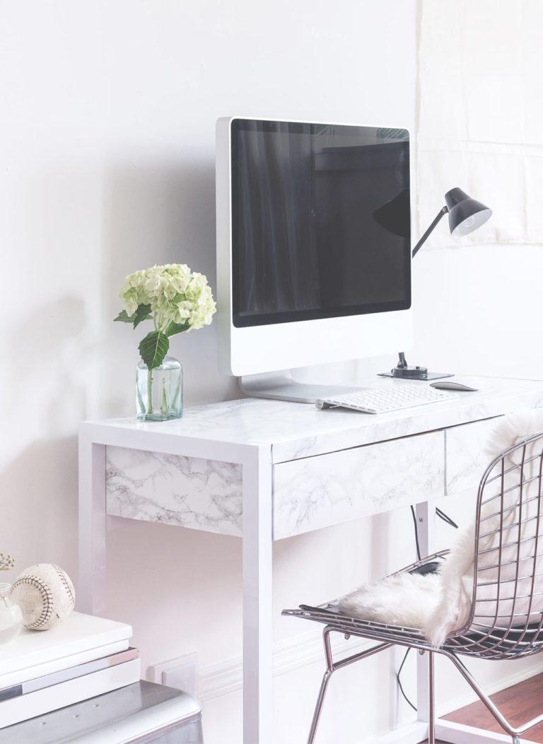 white desk, white chair with desktop computer