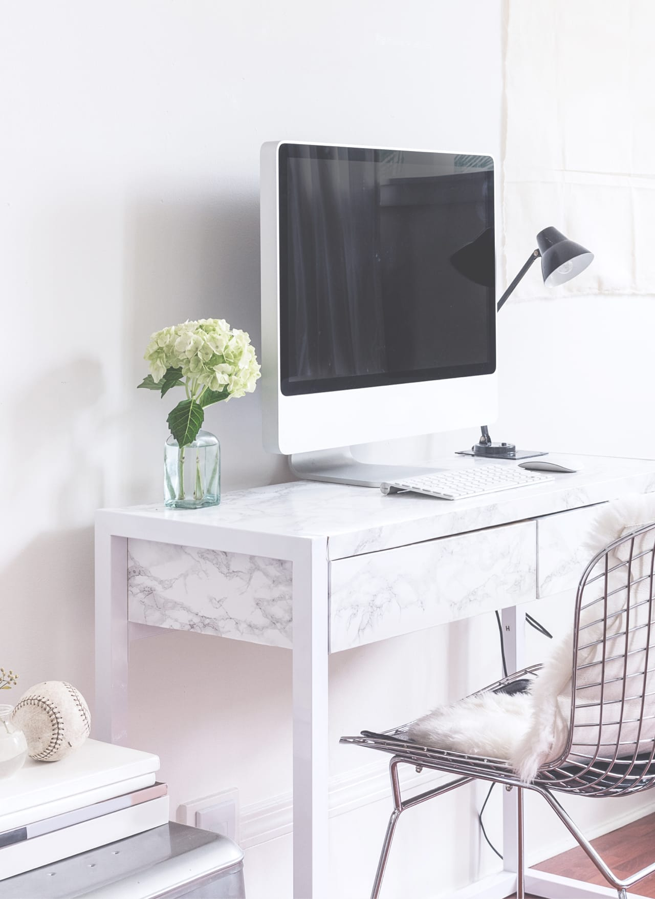 white desk, white chair with desktop computer