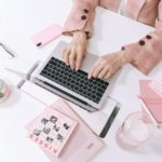 woman in pink on laptop - most in demand freelance skills