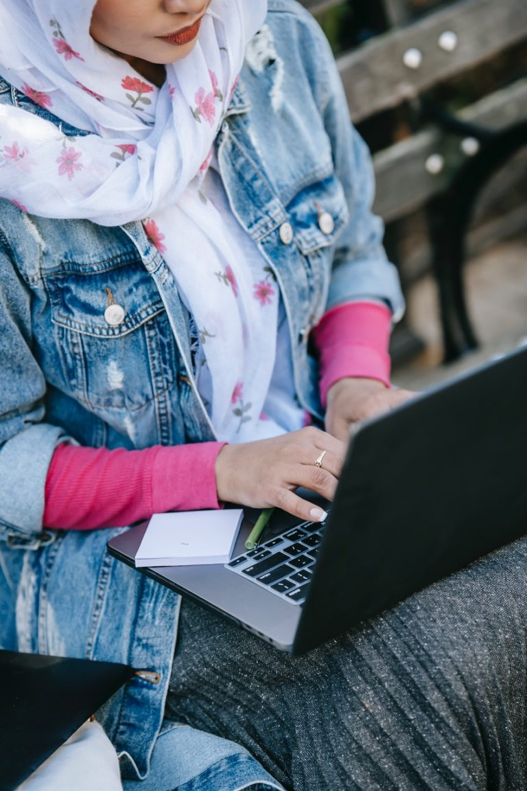 young woman working on laptop how to find online writing gigs