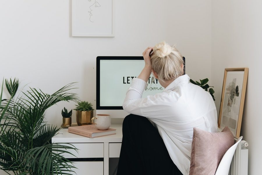 woman at computer seeming overwhelmed or bored - stay motivated working from home